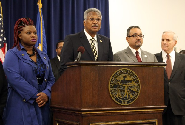 W.C. Jordan Jr., NAACP president for Minnesota and the Dakotas, speaks April 28, 2016, about Gov. Mark Dayton's request for an independent auditor to examine whether state government is providing equitable opportunities to minority business and people of color. Joining Jordan are, from left, Nekima Levy-Pounds, of the Minneapolis NAACP chapter, Jeffry Martin, president of the St. Paul NAACP chapter, and Gov. Mark Dayton, who all spoke in support of the audit. (Pioneer Press: Christopher Magan)