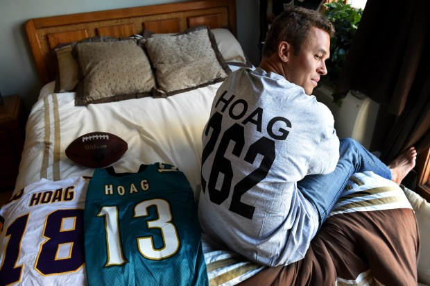 Ryan Hoag, the 2003 Mr. Irrelevant, shows his Minnesota Vikings and Jacksonville Jaguars jerseys at his condo in Minneapolis on Wednesday, April 13, 2016. This is the 40th anniversary of Mr. Irrelevant, the guy who is taken with the last pick in the draft and goes to Newport Beach, California, in June for a big ceremony and is presented the Lowsman Trophy. He later went on to appear on The Bachelorette in 2008, The Bachelor Pad in 2012, and is now a tennis coach at Washburn High School in Minneapolis and working for a drone company making videos. (Pioneer Press: Jean Pieri)