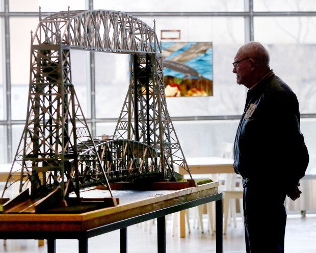 t5.10.16 Bob King -- kingMODEL0511c2 -- Ralph Andres of Proctor looks over his homemade Aerial Lift Bridge before a glass case is slipped over to protect it at the Great Lakes Aquarium Tuesday morning. Bob King / rking@duluthnews.com
