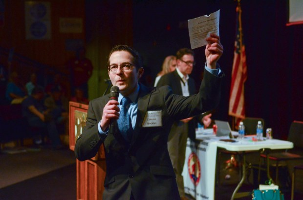 Candidate David Gerson waves a flyer criticizing his fundraising before delegates at the 2nd Congressional District Republican Convention on Saturday, May 7, 2016. Though Gerson tried to rebut arguments that he would be a poor general election candidate, they contributed to him losing the party endorsement. (Pioneer Press: David Montgomery)