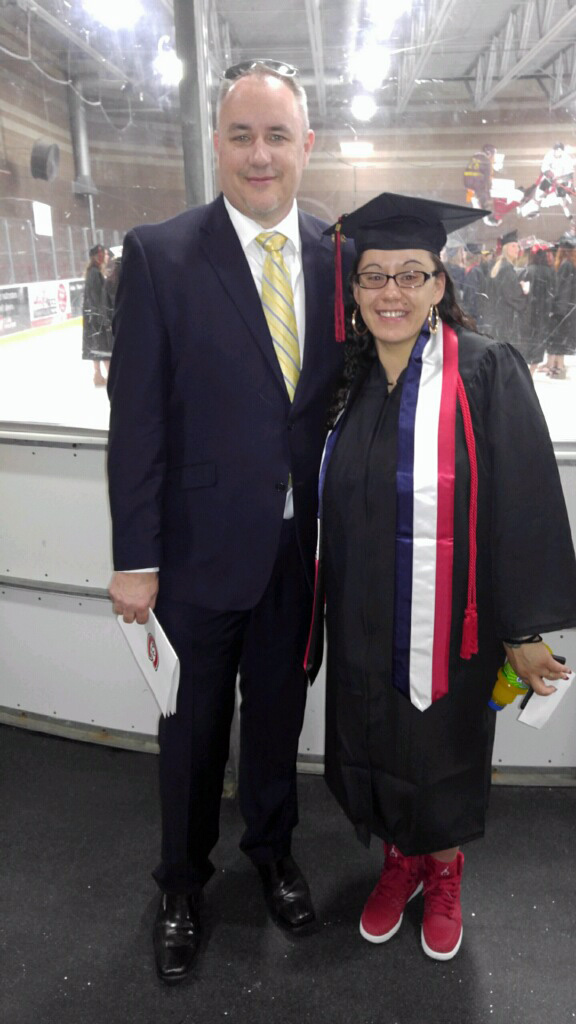Former Minneapolis police officer Andrew Schmidt, left, poses with Eleana Garcia during commencement ceremonies Friday, May 6, 2016 at St. Cloud State University. Garcia, who graduated with a degree in psychology and women's studies, was victimized at 13 and forced to work for a large teen prostitution ring based in the Twin Cities. With Garcia's help, Schmidt and other cops built a federal case against the ring leaders. Photo courtesy of Andrew Schmidt.
