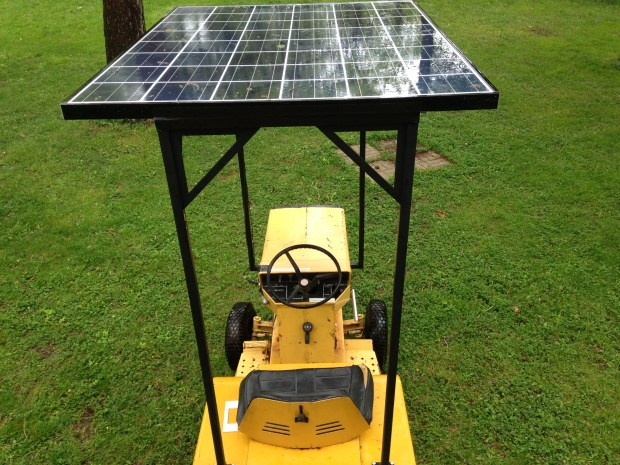 "At the Minneapolis/St. Paul Mini Maker Faire , the Ghost Trolley will be pulled by ""the Tesla of riding lawn mowers,"" a 1971 General Electric garden tractor converted to solar power. (Richard Chin)"