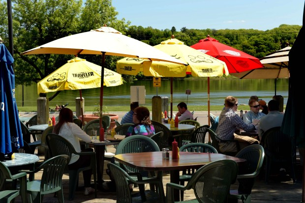 Diners eat lunch overlooking the St. Croix River from the patio at Freight House in downtown Stillwater on Wednesday, May 18, 2016. (Pioneer Press: Scott Takushi)