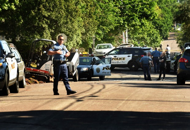 Police officers control the scene near 2163 Minnehaha Ave. E., St. Paul,  where an officer-involved shooting took place Thursday afternoon, May 26, 2016.  (Pioneer Press: Scott Takushi)