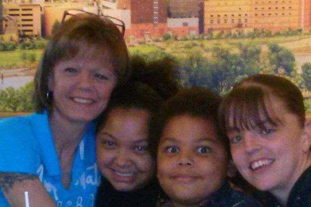Erin Durham, right, is shown with her two children, center, and her mother, Brenda Moore, left. Durham has died from injuries she suffered when a car struck her in a St. Paul crosswalk, after she'd seen her son get on his school bus. (Courtesy of family)