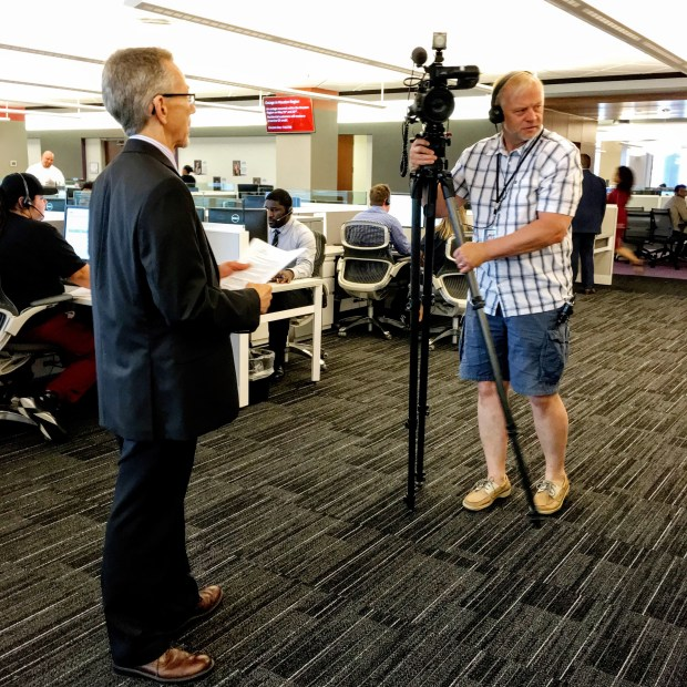 A Twin Cities television-station cameraman sets up as Comcast public-relations staffer looks on. (Pioneer Press: Julio Ojeda-Zapata)