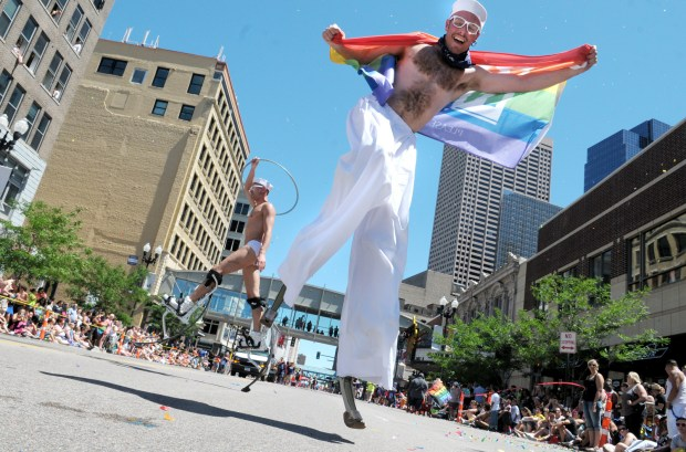 Eddy Wilbers, right, and Justen Pohl, back left, entertain the crowd as part of the Ketel One Vodka float during the 2014 Ashley Rukes GLBT Pride Parade along Hennepin Avenue in downtown Minneapolis on Sunday, June 29,2014 . (Pioneer Press: Sherri LaRose-Chiglo)