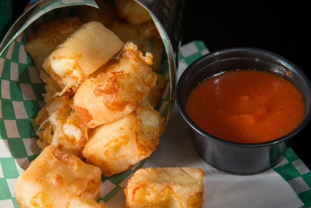 Deep fried grilled cheese bites: White cheddar cheese blended with beer batter, cubed and deep-fried for a taste reminiscent of a grilled cheese sandwich. Served with a bloody mary mix marinara. At O'Gara's at the Fair on the southwest corner of Dan Patch Avenue and Cosgrove Street. (Courtesy of Minnesota State Fair)
