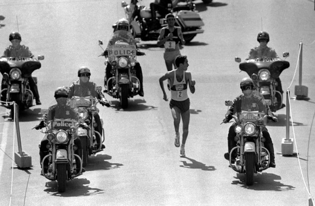 **FILE** Alberto Salazar of Wayland, Mass.,looks over his shoulder to check on Dick Beardsley, rear, of Rush City, Minnesota, as they neared the finish line April 19, 1982 in the 86th annual Boston Marathon. Salazar went on to win in 2:08.51. Beardsley followed by two seconds. Since that race, they've talked and met only a few times, never ran in the same marathon again, and neither returned to run in the Boston Marathon. Salazar, 43, and Beardsley, 46, will be together again for events leading up tothe April 15 Boston Marathon. (AP Photo/files)