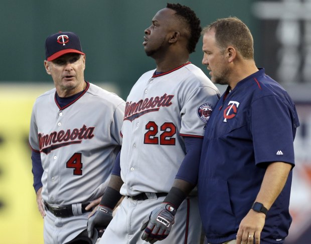Minnesota Twins manager Paul Molitor, left, and a trainer walk Miguel Sano (22) off the field after an injury suffered in the third inning of a baseball game against the Oakland Athletics on Tuesday, May 31, 2016, in Oakland, Calif. Sano left the game. (AP Photo/Ben Margot)