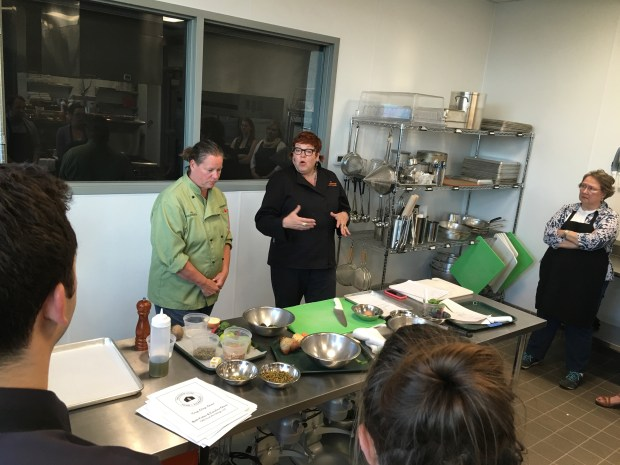 """June 9, 2016 photo of Beth Fisher, left, and Caroline Glawe teach a class on making a """"CSA bowl"""" at The Good Acre in Falcon Heights. (Pioneer Press: Jessica Fleming)"""