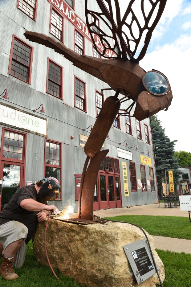 """Lucky Dragonfly Gong,"" an original outdoor sculpture by Dan Massopust, is installed in downtown Stillwater by welder and sculptor John Hughes, Wednesday, June 1, 2016. (Pioneer Press: Scott Takushi)"