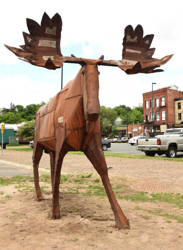 "An original outdoor sculpture by John Hughes titled ""That's A Lot of Bull"" is installed in downtown Stillwater, Wednesday, June 1, 2016. (Pioneer Press: Scott Takushi)"