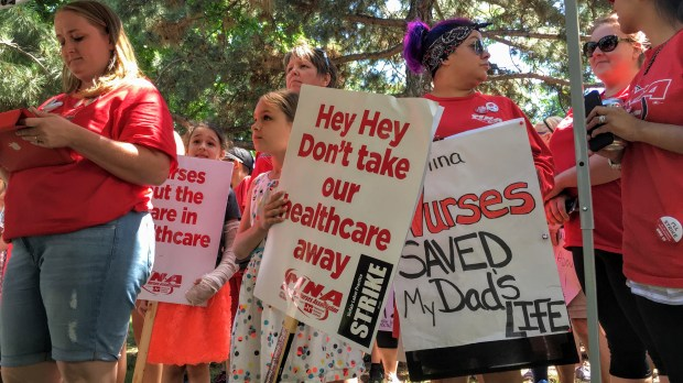 On-strike Allina Health nurses, some with family members in tow, gathered in Minneapolis' Stewart Park on Monday during a lull in their picketing outside nearby Abbott Northwestern Hospital. (Pioneer Press: Julio Ojeda-Zapata)