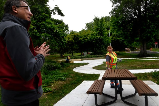 Harland Hiemstra, left, public affairs officer with the Minnesota Department of Natural Resources (DNR), and Martha Reger, DNR Parks & Trails district supervisor, show new picnic tables and walkways at the St. Croix Boom Site Thursday, June 23, 2016. After being closed for two months for a major makeover, the historic St. Croix Boom Site north of downtown Stillwater is slated to reopen the first week of July after a $500,000 makeover. (Pioneer Press: Jean Pieri)