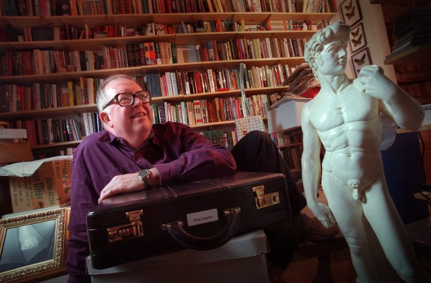 More than 10,000 items in the Jean-Nickolaus Tretter collection of gay, lesbian, bisexual, and transgender materials will be donated to the University of Minnesota. The collection includes books, magazines, erotica, phallic symbols, matchbooks from gay bars, videos and much more. Tretter is pictured in his St. Paul apartment with part of his collection in a Dec. 2000 file photo. (Pioneer Press File)