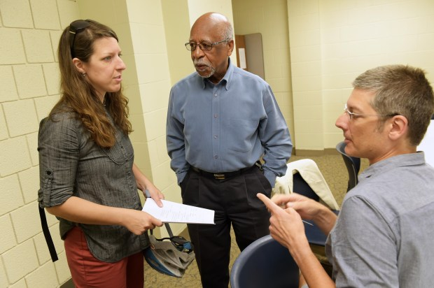 From left: Amy Gundermann, Marvin Anderson and Lars Christiansen exchange ideas at a meeting to plan community involvement in the design of the I-94 bridges in the Rondo neighborhood in St. Paul, Wednesday, June 8, 2016. Gundermann is Executive Director of the Lexington-Hamline Community Council, Anderson is spearheading the Rondo bridges movement, and Christiansen is with Friendly Streets Initiative. (Pioneer Press: Scott Takushi)