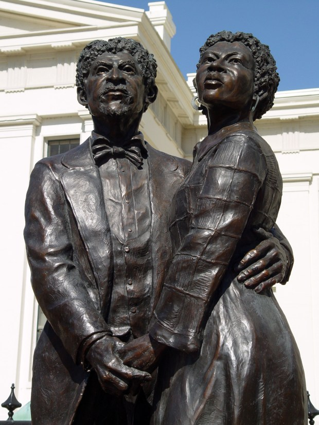Old Courthouse:May 2016 photo of a statue of the enslaved Dred and Harriett Scott is located outside the Old Courthouse in St. Louis. Dedicated on June 8, 2012, the life-size bronze statue by St. Louis sculpture Harry Weber, shows the couple united, as they were in their quest for freedom. (Courtesy of Kathy Henderson)