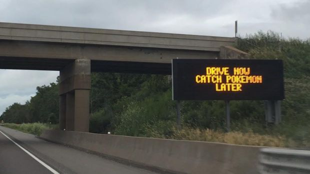 A sign on Interstate 94 near Menomonie, in western Wisconsin, reminds Pokemon Go fans to put down their devices and drive. (Pioneer Press)