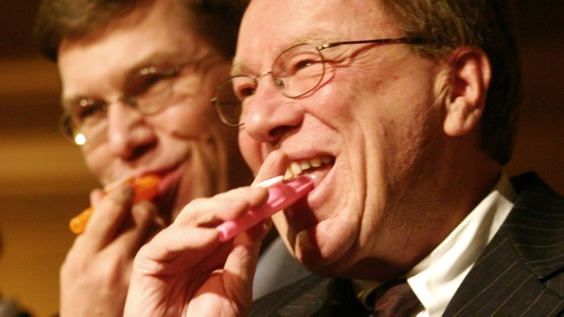 "Sen. James Metzen, DFL-South St. Paul, right, and Rep. Erik Paulsen, R-Eden Prairie, play ""Happy Birthday"" on kazoos during the rotunda celebration of the Capitol's 100th year on Jan. 4, 2005. (Pioneer Press file)"