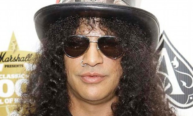 Guitarist Slash of Guns N' Roses and Velvet Revolver is 51. (Associated Press: Joel Ryan)
