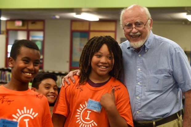 Art Fry, right, a co-inventor of Post-it Notes while at 3M, poses for a photo with campers, from left: Moa Gemeda, 9, Luis Macilla, 10, and Emoni Burgess, 11, at Camp Invention at Central Park Elementary School in Roseville on Wednesday, July 27, 2016. The camp, a summer day camp for kids in grades 1-6, allows youngsters to explore creative problem solving. (Pioneer Press: Scott Takushi)