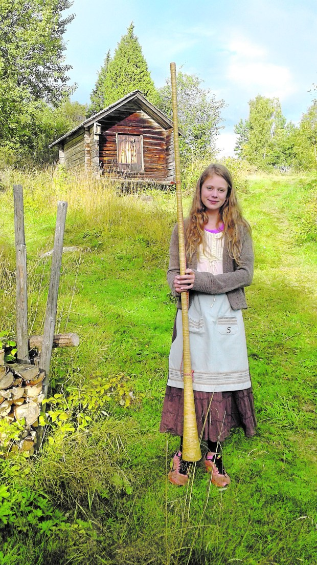 "A young Swedish girl in the ""cow camp"" Bart Sutter visited in Sweden. (Mary Lofgren)"