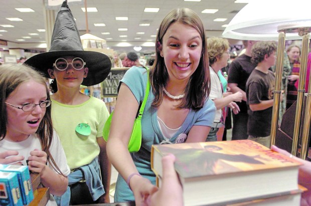 """Sonja Mischke, 10, of St. Paul, from left, Gemma Kumaraea, 10, of Minneapolis and Shelly Peterson, 18, of Roseville get their copies of the much-anticipated """"Harry Potter and the Deathly Hallows"""" at Barnes & Noble Booksellers in Roseville, Minn., July 20, 2007. (Pioneer Press: Brandi Jade Thomas)"""