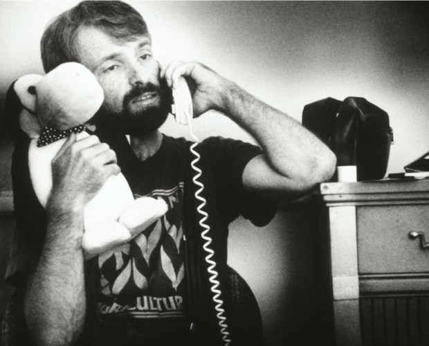 Henningson hugs his Opus doll – a Christmas gift from Hanson – as he alerts friends about Hanson's death. The two men had lived and farmed together for five years. (Pioneer Press: Jean Pieri)