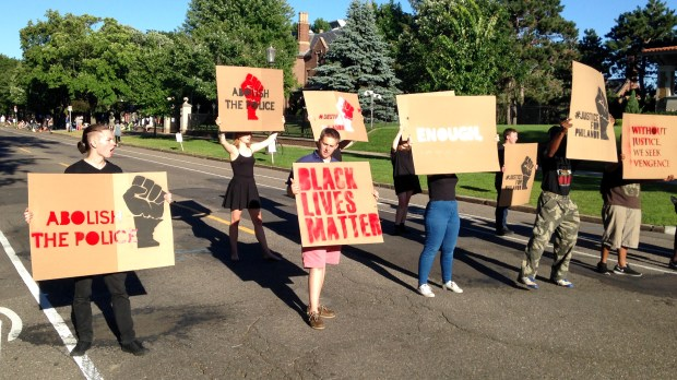 More than 100 demonstrators were in front of the Governor's Residence around 7 p.m. Tuesday, July 12, 2016. Some stenciled signs and about a dozen carrying placards staged a short march from the police barricade at Oxford Street to the police barricade at Chatsworth Street. (Pioneer Press: Jamie DeLage)
