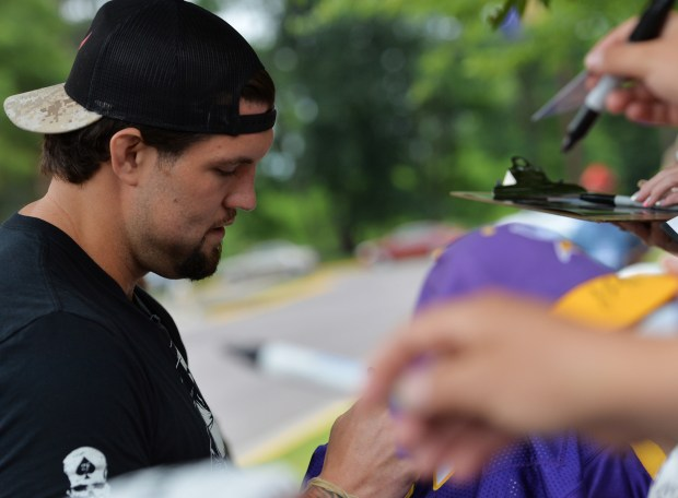 Newly-acquired offensive lineman Alex Boone signs autographs during reporting day for Minnesota Vikings training camp at Minnesota State University in Mankato on Thursday, July 28, 2016. (Pioneer Press: John Autey)