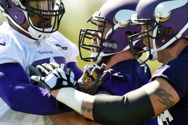 Minnesota Vikings defensive end Everson Griffen, left, is blocked by center John Sullivan, center, and offensive lineman Alex Boone during practice on the first day of the Minnesota Vikings training camp at Minnesota State University in Mankato on Friday, July 29, 2016. (Pioneer Press: John Autey