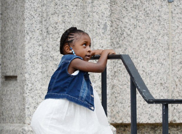 Diamond Reynolds' daughter, Dae'Anna 4, waits outside the Cathedral of St. Paul before Philando Castile's funeral there on Thursday, July 14, 2016. Castile, 32, was shot to death by a police officer during a traffic stop in Falcon Heights on July 6. Dae'Anna and Diamond Reynolds were in the car with Castile. (Pioneer Press: Holly Peterson)