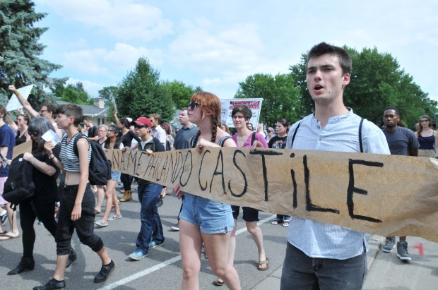 Protesters march down Silver Lake Road, showing their concern over the police shooting death of Philando Castile, in St. Anthony on Sunday afternoon, July 10, 2016. (Pioneer Press: Ginger Pinson)