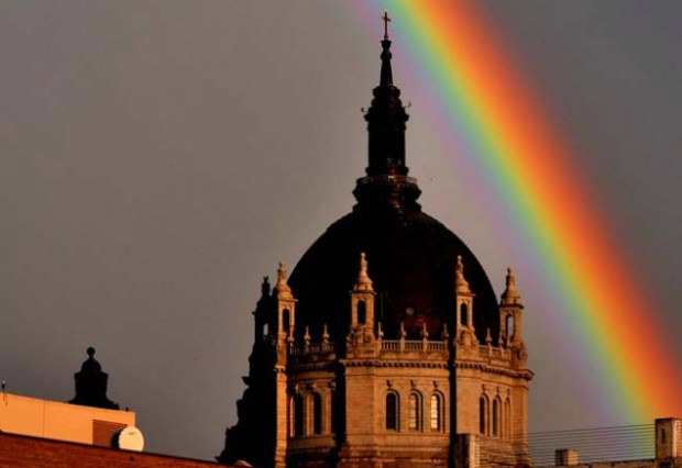 A spectacular rainbow appeared over St. Paul, including the Cathedral of St. Paul, with the St. Paul College in the foreground, Wednesday evening, June 6, 2012. (Pioneer Press: Chris Polydoroff)