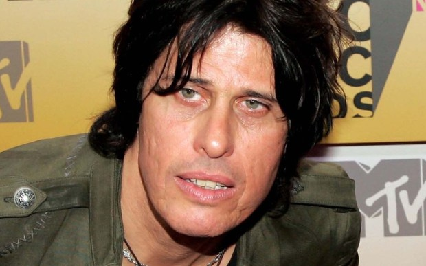 Guitarist Dean DeLeo of '90s rockers Stone Temple Pilots -- who spent hours to get that messy hair look, whaddya bet? -- is 55. (Getty Images: Bryan Bedder)