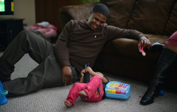 James Fields with his daughter Ja'Mes in their South St. Paul home, Saturday, January 20, 2013. (Pioneer Press: Chris Polydoroff)