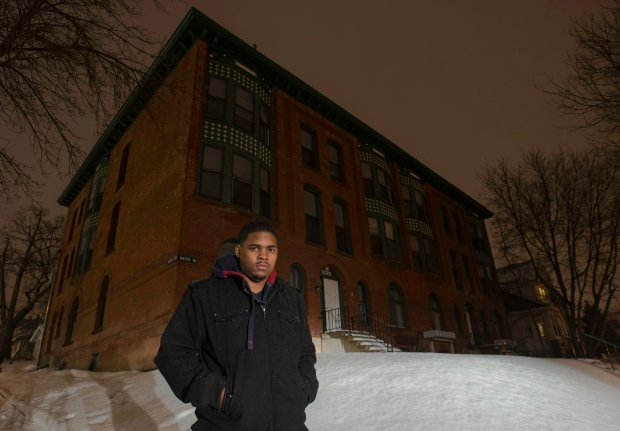 """James Fields stands in front of the """"Red Building"""" Wednesday, February 13, 2013,  where he and many of the East Side Boys lived and congregated. The building at 238 Bates Avenue is now unoccupied. (Pioneer Press: Chris Polydoroff)"""