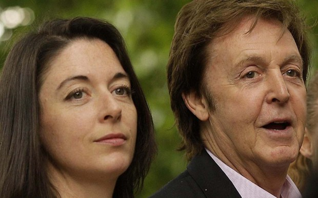 "Mary McCartney — a spitting image of her dad, Sir Paul, right, but following her mother Linda Eastman McCartney's footsteps in photography — is 47. She was named after Paul's mother, mentioned in the song ""Let It Be."" (And you thought it was a different kind of Mother Mary!) She's also the baby peering from her father's coat in the ""cherries"" album. (Getty Images: Shaun Curry)"