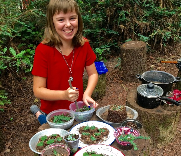 Molly Hofer, 11, serves culinary creativity at her play restaurant, using woodland finds, dirt and creek water. (Photo courtesy of Donna Erickson)