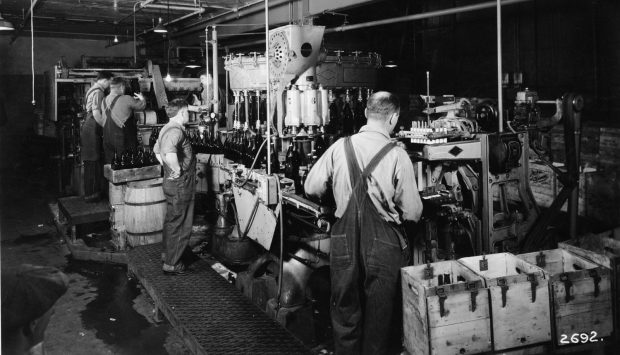 Workers at the Hamm's Brewery fill and label half-gallon bottles with lager beer about 1950. (Minnesota Historical Society)
