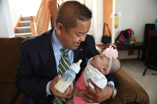 St. Paul City Council member Dai Thao takes care of his newborn daughter Aden, who needs round-the-clock care for her medical issues, in his home Tuesday,  August 23, 2016 in St. Paul.  Thao has been one of the biggest advocates for mandatory paid sick leave.  (Pioneer Press: Scott Takushi)