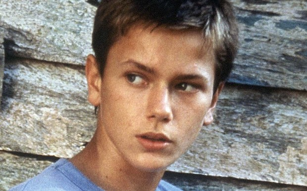 Actor River Phoenix -- eldest brother to Rain, Joaquin, Liberty, and Summer -- was born on this date in 1970 and died at age 23 in front of L.A.'s Viper Room, putting the nightclub on the tourist map. He's shown shown in 1986. (Associated Press file photo)