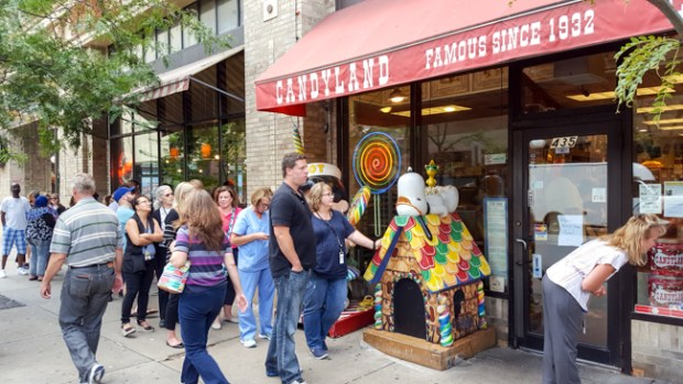 Customers wait in line outside Candyland in downtown St. Paul during the lunch hour Thursday, Aug. 11, 2016. Candyland was celebrating its 84th anniversary by offering 84-cent popcorn. (Pioneer Press: Andy Rathbun)
