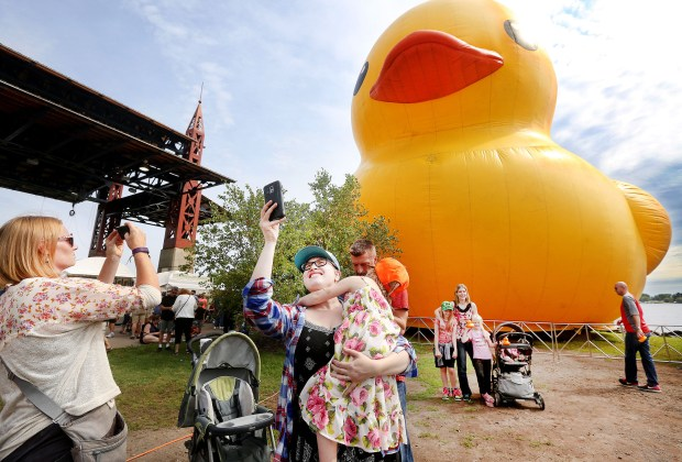 Amanda Dahlberg of Elk River, Minn., (left) and Amanda Sundin and her daughter Amelia, 4, of Duluth, snap selfies with the big duck in Bayfront Festival Park during the Tall Ships Duluth festival on Friday morning, Aug. 19, 2016. Bob King / rking@duluthnews.com