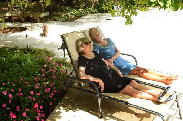 P. J. Lambrecht, left, and her daughter Traci, who write thrillers together from their office near Stillwater under the pseudonym P.J. Tracy, relax in their back yard Tuesday, August 23, 2016. (Pioneer Press: Scott Takushi)