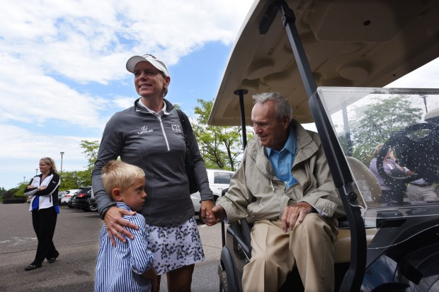 Golf great Annika Sorenstam and her son, Will, 5, greet golf icon Arnold Palmer outside the clubhouse of Royal Golf Club in Lake Elmo, Minn., Thursday, Aug. 4, 2016. Scheduled to open as soon as June 2017, the former Tartan Park Golf Course is being redesigned by the firms of Palmer and Sorenstam. Sorenstam was uninjured after the car she was in was rear-ended earlier in the day in the Twin Cities. (Pioneer Press: Dave Orrick)