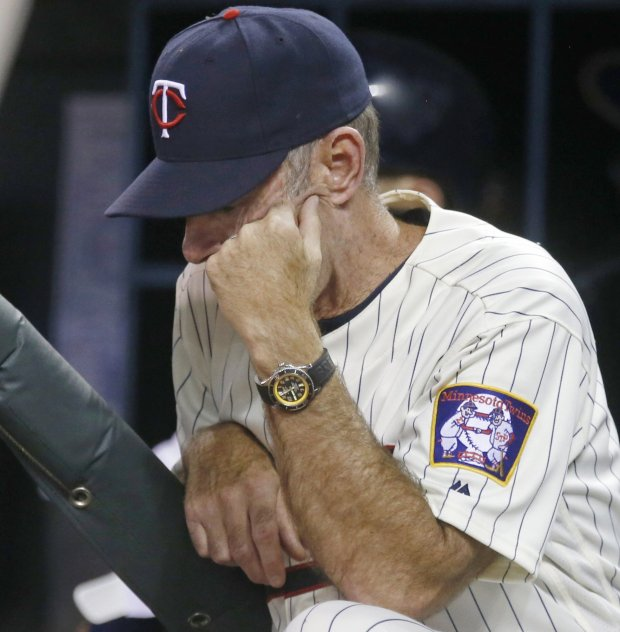 Minnesota Twins manager Paul Molitor rests his head against his hand during the ninth inning of the team's second game of a baseball doubleheader against the Houston Astros on Thursday, Aug. 11, 2016, in Minneapolis. The Astros won 10-2 and won the earlier game 15-7. (AP Photo/Jim Mone)