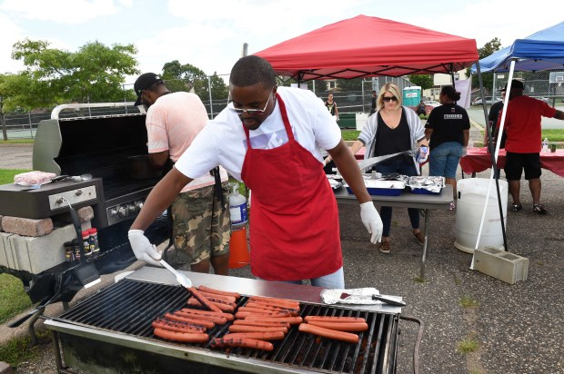 Marcus Freeman worked with the Central High School students and alumni group to raise money at a fundraiser, held at Central High School in St. Paul for Philando Castile, Sunday, August 21, 2016. (Pioneer Press: Scott Takushi)
