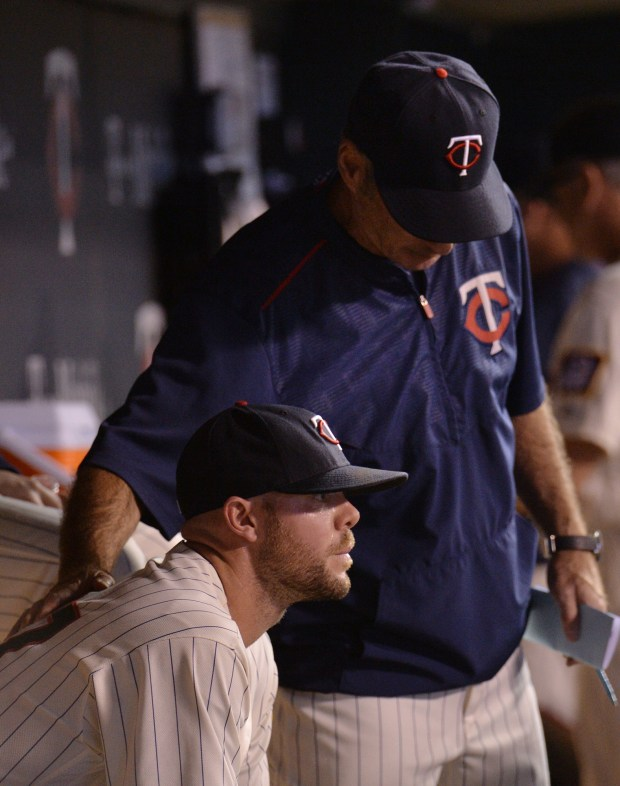 Minnesota Twins relief pitcher Ryan Pressly is consoled by Minnesota Twins manager Paul Molitor after giving up 3 runs to the Detroit Tigers in the eighth inning at Target Field on Wednesday, August 28, 2016. The Tigers beat the Twins, 9-4 (Pioneer Press: John Autey)